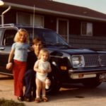 Kathleen and Jessica stand with their father Douglass in front of the new 1979 Chevette. (6/1979)