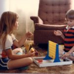 Cousins Jessica and Christopher play Connect Four on the floor at Grandma and Grandpa's house in Valparaiso, Indiana. (6/1982)