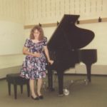 Jessica taking a bow after playing in her second piano recital. (6/13/1991)