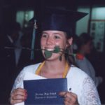 Jessica shows off her high school diploma after her graduation ceremony. (6/9/1995)