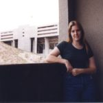 Jessica stands on her balcony at The Towers overlooking Sundevil Stadium. (1/3/1997)