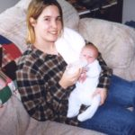 Cole gets held by his Aunt Jessica at the Cole home in Bridgeport, Michigan. (3/15/1998)