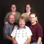 The Green family poses with Jessica Cole during a family sitting. (5/14/2000)
