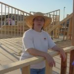 Jessica staring out of the initial framing for their new home in Gilbert, AZ. (7/20/2001)