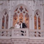 Newlyweds Andrew and Jessica Green pose on the backside of Cinderella's Castle, at Walt Disney World. (2/2/2002)