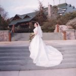 Jessica Green in her wedding gown in front of Wilderness Lodge, at Walt Disney World.