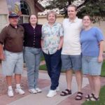 The Green family poses outside the home on Ross Drive in Chandler, Arizona: Jerald, Amy, Karen, Andrew, and Jessica. (8/18/2002)