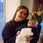 Jessica holds her new baby brother, Noah. (1/17/2004)