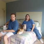Andrew and Jessica pose with their three cats, Olly, Cheetoe, and Tumbleweed at the Gilbert home. (3/4/2004)