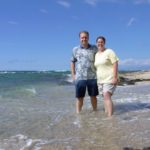 Andrew and Jessica stand in the waves of a Hawaiian beach. (9/5/2004)