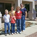 Jessica poses with her sister, nieces, and nephew outside her home. (3/31/2005)