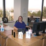 Jessica sits at her desk at the Maricopa County Community Colleges District Office. (1/20/2006)