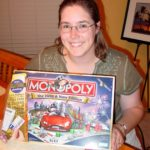 Jessica enjoys her London edition Monopoly with Debit Card Reader. (9/6/2006)
