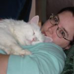 Jessica takes a nap with her kitty, Olly. (11/26/2006)