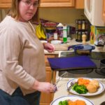 Jessica makes dinner - an actual dinner - after her sister Kathleen gave her a SavingDinner.com recipe subscription for Christmas. (12/31/2006)