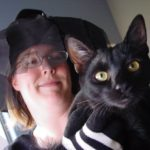 Jessica poses with her kitten Lucky on Halloween. (10/31/2007)