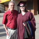 Jessica poses with her father after her Master's graduation ceremony. (5/10/2008)
