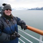 Jessica poses in front of Hubbard Glacier, camera in hand, during an Alaskan cruise. (6/10/2008)