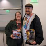 Jessica and Andrew pose with autographed items from the Transformers convention, Botcon 2009. Jessica was waiting for David Kaye, while Andrew was waiting for Peter Cullen. (5/30/2009)