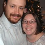 Andrew and Jessica pose together in front of the 2009 Christmas tree. Jessica just had her hair cut short. (12/11/2009)