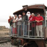 The Green family embarks on a journey on the Santa Claus Express, part of the Verde Canyon Railroad Christmas celebration. Left to Right: Andrew, Jessica, Mrs. Claus, Amy, Mason, Santa, Karen, Jerry. (12/12/2009)