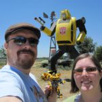 Andrew and Jessica pose in front of a large Bumblebee statue in California. (7/3/2010)