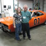 Jessica poses with her father Doug in front of a replica of the General Lee car from Dukes of Hazard at the Corvette Museum. (4/13/2011)