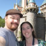 Andrew and Jessica pose in front of Sleeping Beauty's castle at Disneyland. (10/22/2011)