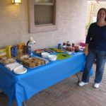 Jessica poses next to an elaborate spread of smores making ingredients for a party. (1/14/2012)