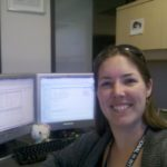 Jessica poses at her work desk at Maricopa Community Colleges District Office. (1/192012)