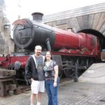 Andrew and Jessica pose in front of the Hogwarts Express at Universal Islands of Adventure (1/27/2012)