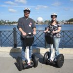 Andrew and Jessica pose on top of Segways they were able to ride around Epcot, Walt Disney World. (2/1/2012)