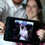 Andrew and Jessica hold up a photo of their wedding, while posing for 10-year anniversary portraits. (2/2/2012)