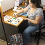 Jessica putting together a LEGO set in her office that she received for Christmas. (12/25/2012)
