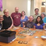 Jessica poses with members of the South Chandler Tabletop Gamers gaming group during a meetup at her home. (7/3/2016)