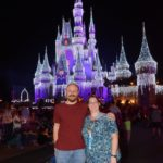 Andrew and Jessica pose in front Cinderella's Castle, which has been decorated for the holidays. (12/13/2016)