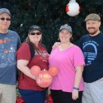 Mason, Amy, Jessica, and Andrew pose in front of a giant Christmas tree found at Epcot, Walt Disney World. (12/15/2016)