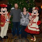 Andrew and Jessica take a photo with Mickey and Minnie Mouse. (12/21/2016)