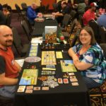 Jessica and Andrew playing the game A Feast for Odin at Meeplecon in Las Vegas, NV. (3/17/2017)