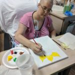 Jessica paints a sunflower during her first stay at the Mayo Clinic. (3/14/2018)